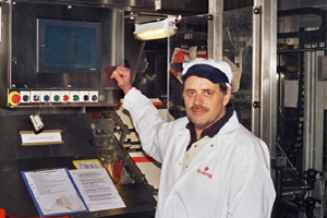 Figure 4. Lars Bengtsson demonstrates the use of the touch screen for starting and monitoring the filling machine.