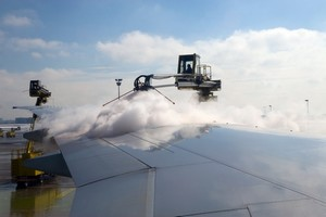 Plane being deiced