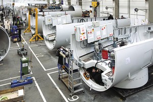 Assembly of nacelles for Siemens 2.3-MW wind turbines is shown at the company's nacelle production facility in Brande, Denmark. (Image courtesy of Siemens Energy.)
