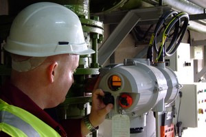A Rotork engineer locally operates a newly installed Rotork IQT actuator during commissioning